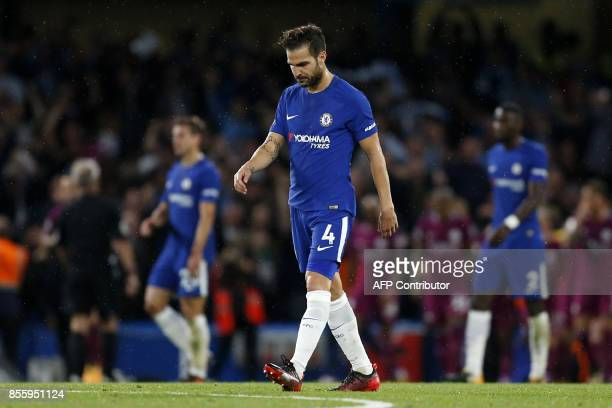 Chelsea's Spanish midfielder Cesc Fabregas reacts after they concede the first goal during the English Premier League football match between Chelsea...