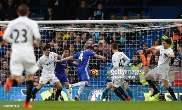 Chelsea's Spanish midfielder Cesc Fabregas scores the opening goal during the English Premier League football match between Chelsea and Swansea at...