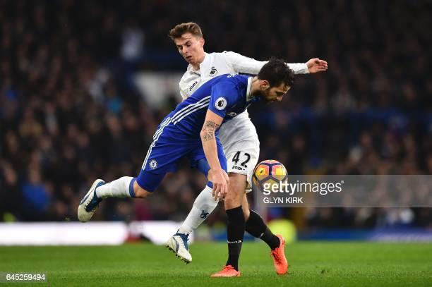 Chelsea's Spanish midfielder Cesc Fabregas tangles with Swansea City's English midfielder Tom Carroll during the English Premier League football...