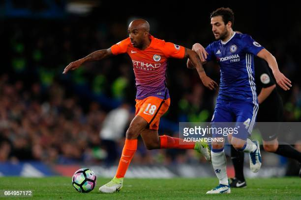 Chelsea's Spanish midfielder Cesc Fabregas vies with Manchester City's English midfielder Fabian Delph during the English Premier League football...
