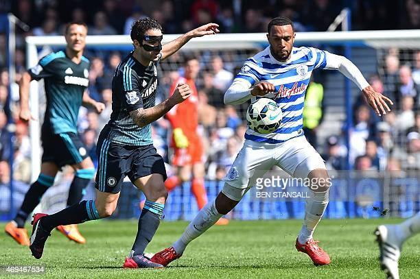 Chelsea's Spanish midfielder Cesc Fabregas vies with Queens Park Rangers' Englishborn Scottish midfielder Matt Phillips during the English Premier...