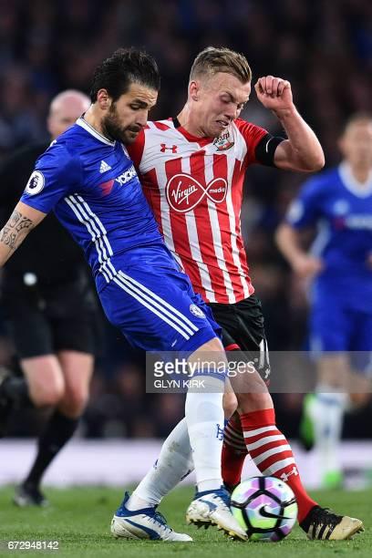 Chelsea's Spanish midfielder Cesc Fabregas vies with Southampton's English midfielder James WardProwse during the English Premier League football...