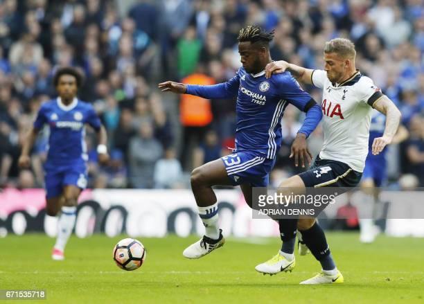 Chelsea's Spanish midfielder Cesc Fabregas vies with Tottenham Hotspur's Danish midfielder Christian Eriksen during the FA Cup semifinal football...