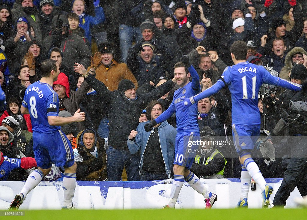 "Chelsea's Spanish midfielder Juan Mata celebrates scoring the first goal during their English Premier League football match against Arsenal at Stamford Bridge in London on January 20, 2013. USE. No use with unauthorized audio, video, data, fixture lists, club/league logos or ""live"" services. Online in-match use limited to 45 images, no video emulation. No use in betting, games or single club/league/player publications."