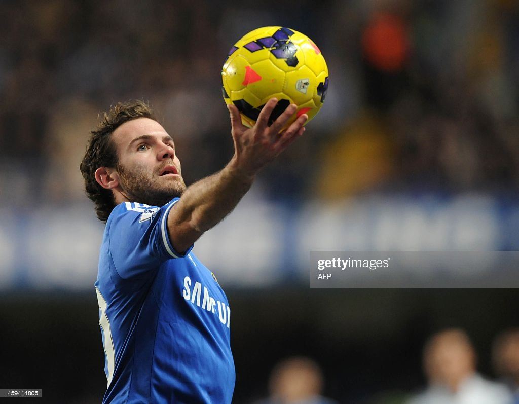 Chelsea's Spanish midfielder Juan Mata holds the ball up during the English Premier League football match between Chelsea and Swansea City at Stamford Bridge in London on December 26, 2013. Chelsea won the game 1-0. USE. No use with unauthorized audio, video, data, fixture lists, club/league logos or live services. Online in-match use limited to 45 images, no video emulation. No use in betting, games or single club/league/player publications.