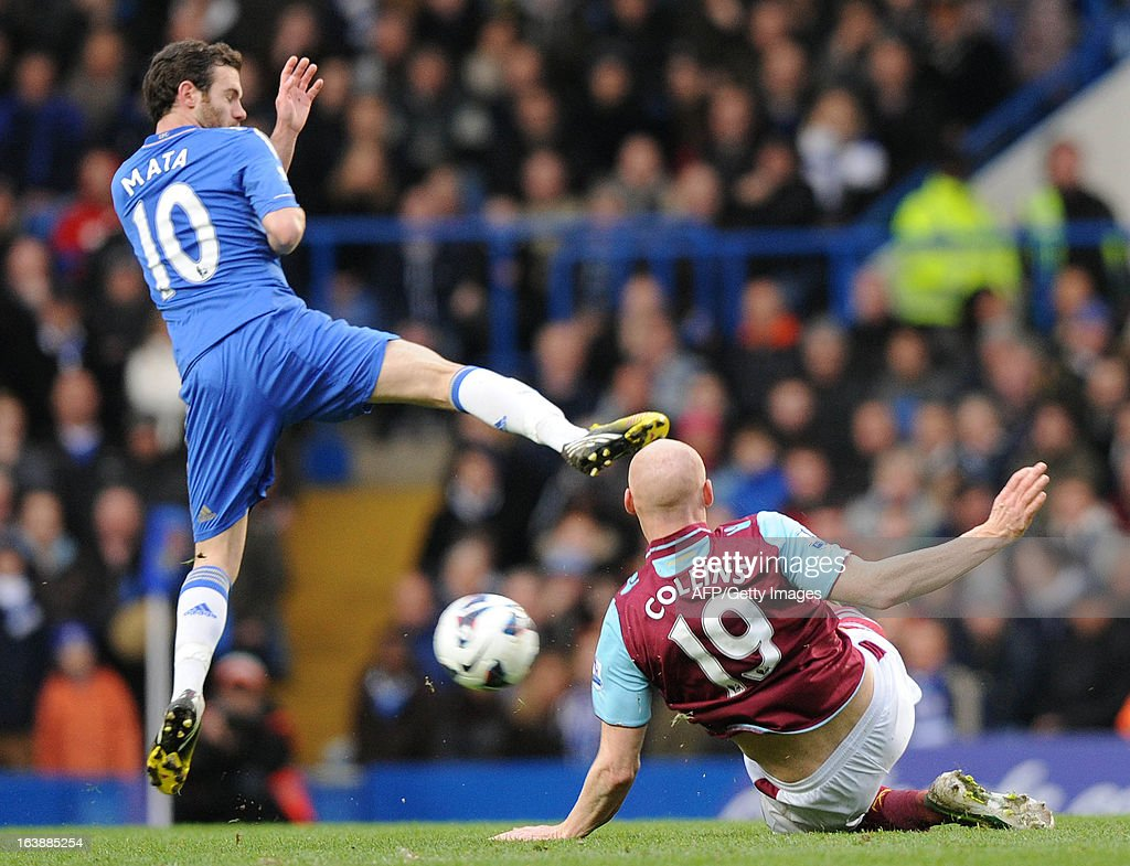 "Chelsea's Spanish midfielder Juan Mata (L) vies with West Ham United's Welsh defender James Collins (R) during the English Premier League football match between Chelsea and West Ham United at Stamford Bridge in London on March 17, 2013. USE. No use with unauthorized audio, video, data, fixture lists, club/league logos or ""live"" services. Online in-match use limited to 45 images, no video emulation. No use in betting, games or single club/league/player publications."
