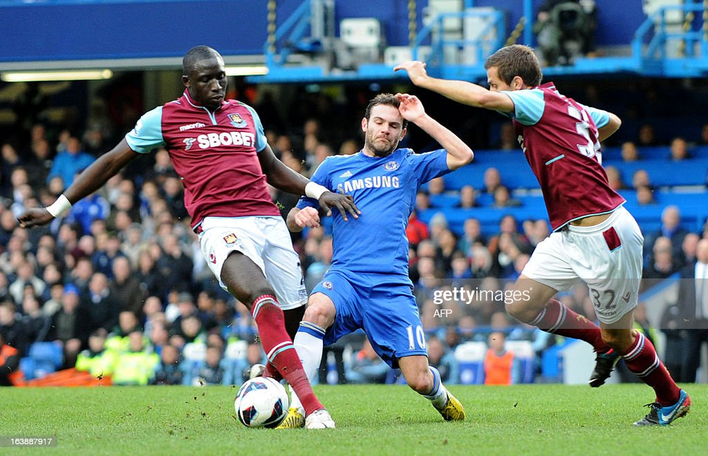 """Chelsea's Spanish midfielder Juan Mata (L) vies with West Ham United's Senegalese midfielder Mohamed Diame (L) and West Ham United's English midfielder Gary O'Neil (R) during the English Premier League football match between Chelsea and West Ham United at Stamford Bridge in London on March 17, 2013. USE. No use with unauthorized audio, video, data, fixture lists, club/league logos or """"live"""" services. Online in-match use limited to 45 images, no video emulation. No use in betting, games or single club/league/player publications."""