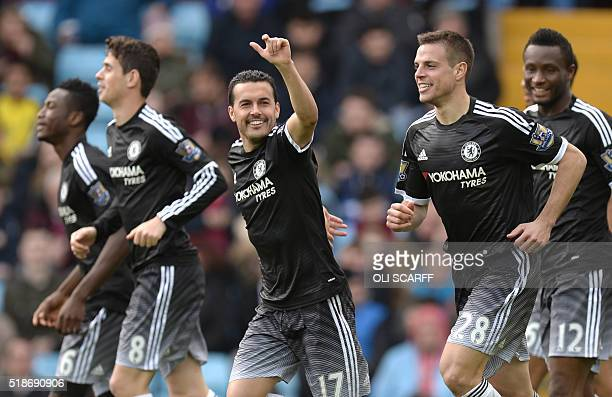 Chelsea's Spanish midfielder Pedro celebrates after scoring during the English Premier League football match between Aston Villa and Chelsea at Villa...
