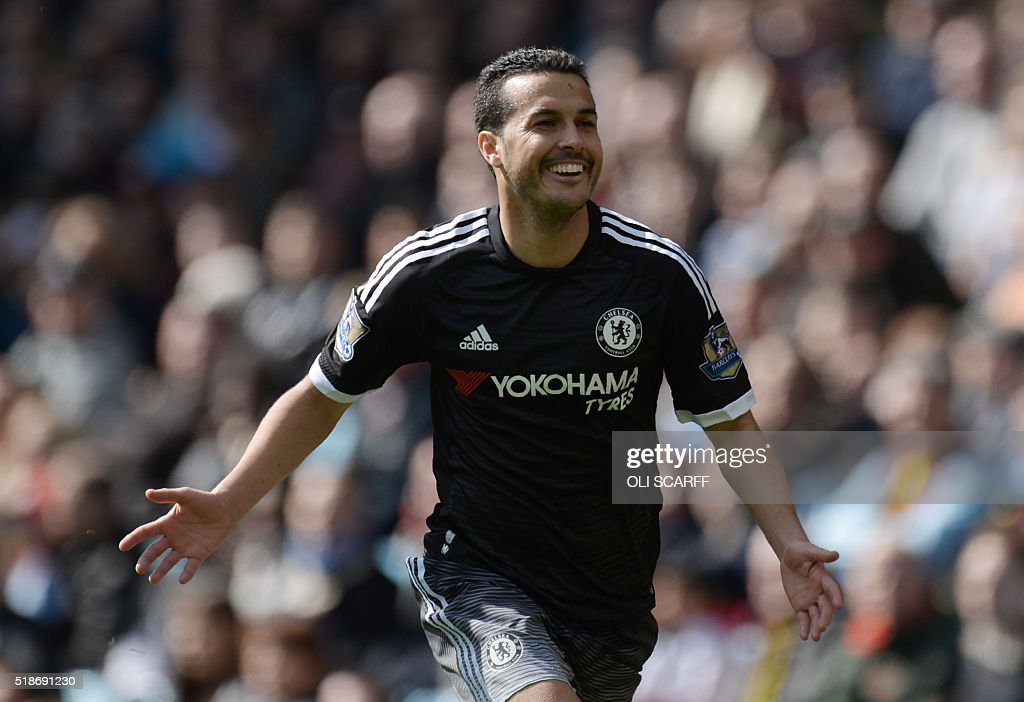 Chelsea's Spanish midfielder Pedro celebrates after scoring his second goal and Chelsea's fourth during the English Premier League football match between Aston Villa and Chelsea at Villa Park in Birmingham, central England on April 2, 2016. / AFP / OLI SCARFF / RESTRICTED TO EDITORIAL USE. No use with unauthorized audio, video, data, fixture lists, club/league logos or 'live' services. Online in-match use limited to 75 images, no video emulation. No use in betting, games or single club/league/player publications. /