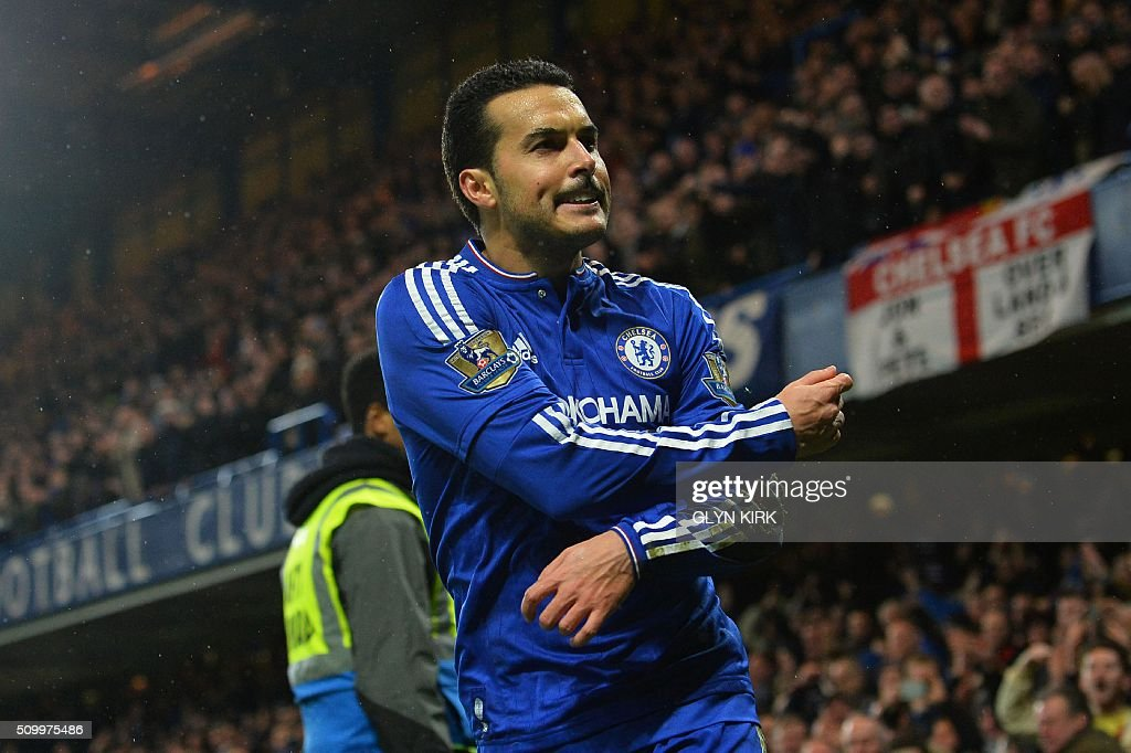 Chelsea's Spanish midfielder Pedro celebrates scoring his team's second goal during the English Premier League football match between Chelsea and Newcastle United at Stamford Bridge in London on February 13, 2016. / AFP / GLYN KIRK / RESTRICTED TO EDITORIAL USE. No use with unauthorized audio, video, data, fixture lists, club/league logos or 'live' services. Online in-match use limited to 75 images, no video emulation. No use in betting, games or single club/league/player publications. /