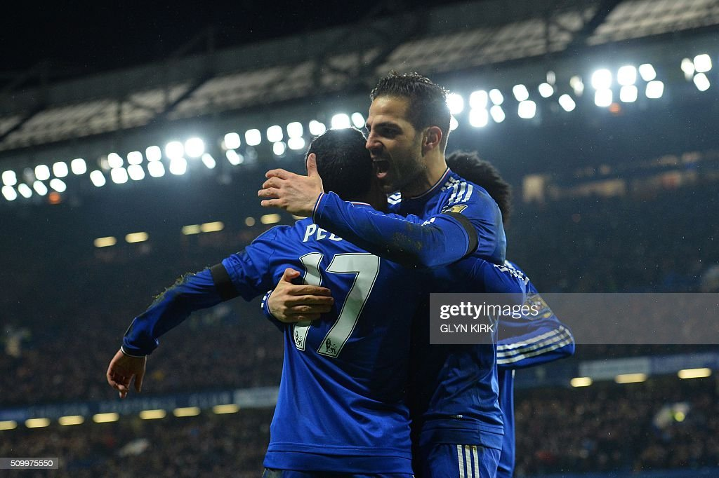 Chelsea's Spanish midfielder Pedro (L) celebrates scoring his team's second goal with Chelsea's Spanish midfielder Cesc Fabregas during the English Premier League football match between Chelsea and Newcastle United at Stamford Bridge in London on February 13, 2016. / AFP / GLYN KIRK / RESTRICTED TO EDITORIAL USE. No use with unauthorized audio, video, data, fixture lists, club/league logos or 'live' services. Online in-match use limited to 75 images, no video emulation. No use in betting, games or single club/league/player publications. /