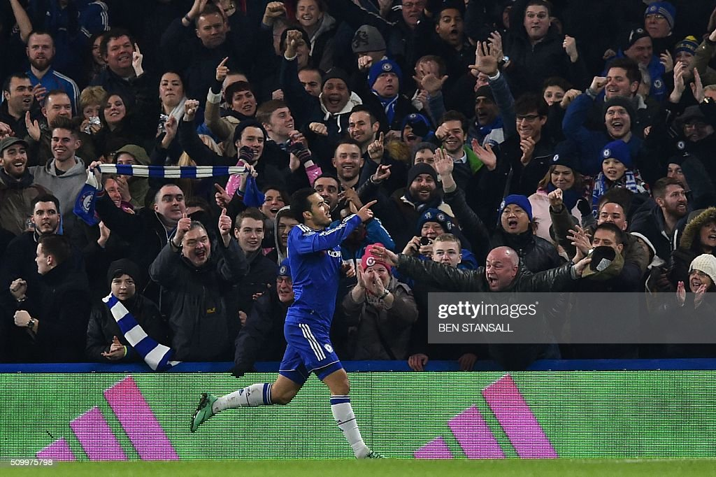 Chelsea's Spanish midfielder Pedro celebrates scoring his team's second goal during the English Premier League football match between Chelsea and Newcastle United at Stamford Bridge in London on February 13, 2016. / AFP / BEN STANSALL / RESTRICTED TO EDITORIAL USE. No use with unauthorized audio, video, data, fixture lists, club/league logos or 'live' services. Online in-match use limited to 75 images, no video emulation. No use in betting, games or single club/league/player publications. /