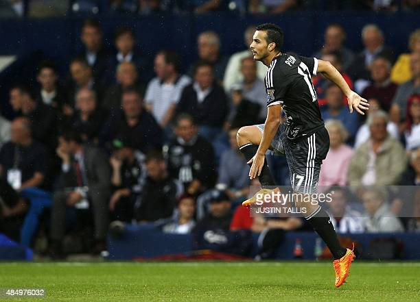 Chelsea's Spanish midfielder Pedro celebrates scoring the opening goal of the English Premier League football match between West Bromwich Albion and...