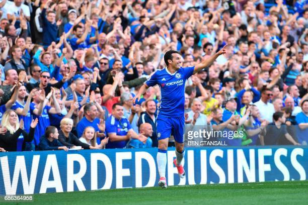 Chelsea's Spanish midfielder Pedro celebrates scoring their third goal during the English Premier League football match between Chelsea and...