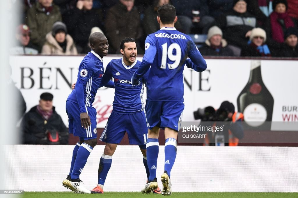 Chelsea's Spanish midfielder Pedro (2nd L) celebrates with teammates after scoring the opening goal of the English Premier League football match between Burnley and Chelsea at Turf Moor in Burnley, north west England on February 12, 2017. / AFP / Oli SCARFF / RESTRICTED TO EDITORIAL USE. No use with unauthorized audio, video, data, fixture lists, club/league logos or 'live' services. Online in-match use limited to 75 images, no video emulation. No use in betting, games or single club/league/player publications. /