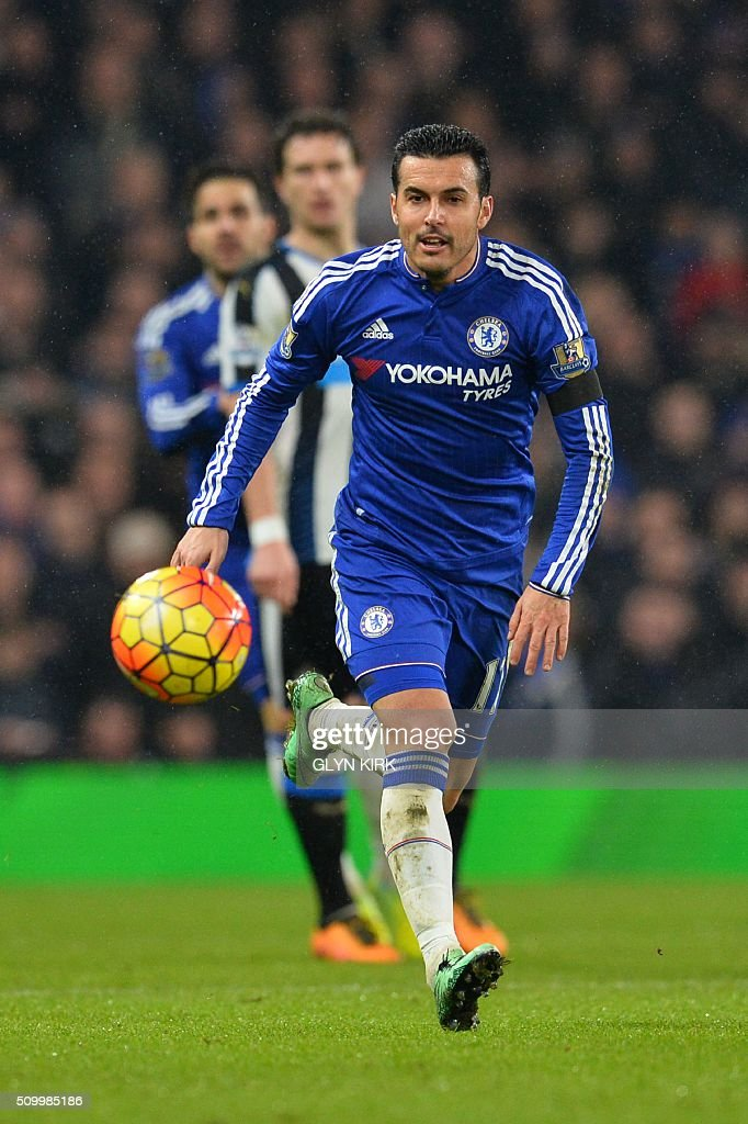 Chelsea's Spanish midfielder Pedro chases down the ball during the English Premier League football match between Chelsea and Newcastle United at Stamford Bridge in London on February 13, 2016. / AFP / GLYN KIRK / RESTRICTED TO EDITORIAL USE. No use with unauthorized audio, video, data, fixture lists, club/league logos or 'live' services. Online in-match use limited to 75 images, no video emulation. No use in betting, games or single club/league/player publications. /