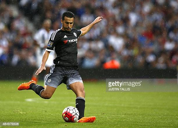 Chelsea's Spanish midfielder Pedro crosses the ball during the English Premier League football match between West Bromwich Albion and Chelsea at The...
