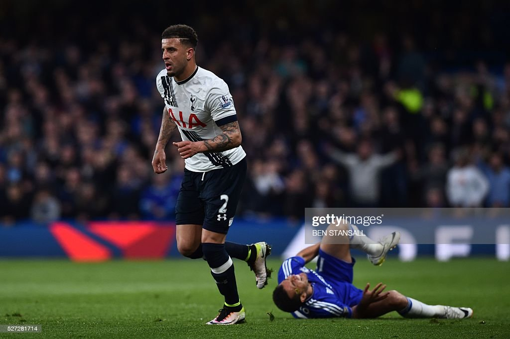 Chelsea's Spanish midfielder Pedro (R) lies on the pitch after a challenge from Tottenham Hotspur's English defender Kyle Walker (L) that earned Walker a yellow card during the English Premier League football match between Chelsea and Tottenham Hotspur at Stamford Bridge in London on May 2, 2016. / AFP / BEN STANSALL / RESTRICTED TO EDITORIAL USE. No use with unauthorized audio, video, data, fixture lists, club/league logos or 'live' services. Online in-match use limited to 75 images, no video emulation. No use in betting, games or single club/league/player publications. /