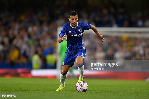 Chelsea's Spanish midfielder Pedro runs with the ball during the English League Cup second round football match between Chelsea and Bristol Rovers at...