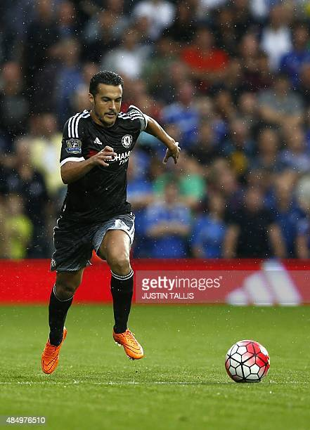 Chelsea's Spanish midfielder Pedro runs with the ball during the English Premier League football match between West Bromwich Albion and Chelsea at...