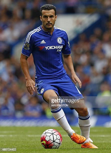 Chelsea's Spanish midfielder Pedro runs with the ball during the English Premier League football match between Chelsea and Crystal Palace at Stamford...