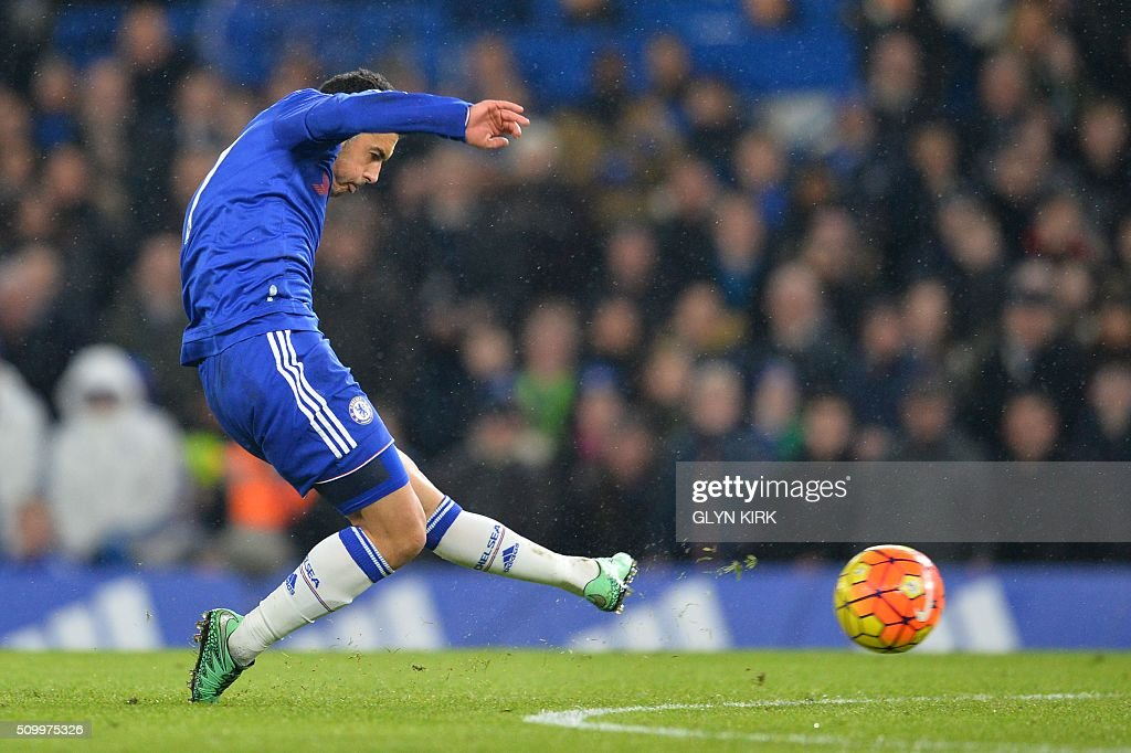Chelsea's Spanish midfielder Pedro scores his team's second goal during the English Premier League football match between Chelsea and Newcastle United at Stamford Bridge in London on February 13, 2016. / AFP / GLYN KIRK / RESTRICTED TO EDITORIAL USE. No use with unauthorized audio, video, data, fixture lists, club/league logos or 'live' services. Online in-match use limited to 75 images, no video emulation. No use in betting, games or single club/league/player publications. /