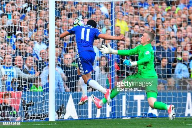 Chelsea's Spanish midfielder Pedro scores their third goal during the English Premier League football match between Chelsea and Sunderland at...