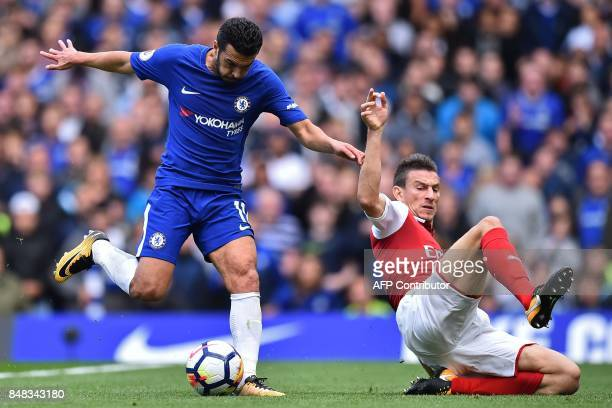Chelsea's Spanish midfielder Pedro vies with Arsenal's French defender Laurent Koscielny during the English Premier League football match between...