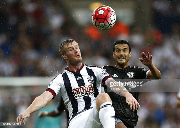 Chelsea's Spanish midfielder Pedro vies with West Bromwich Albion's Northern Irish midfielder Chris Brunt during the English Premier League football...