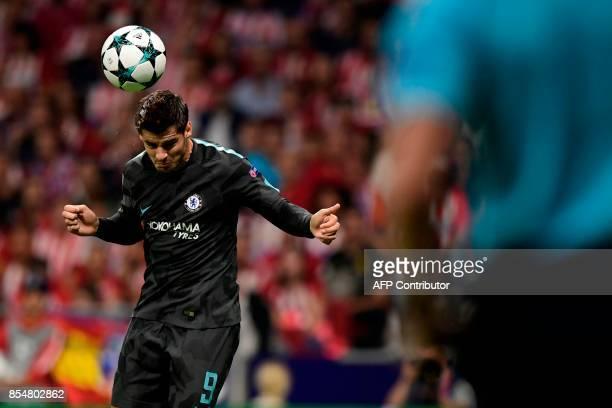 Chelsea's Spanish striker Alvaro Morata heads the ball during the UEFA Champions League Group C football match Club Atletico de Madrid vs Chelsea FC...
