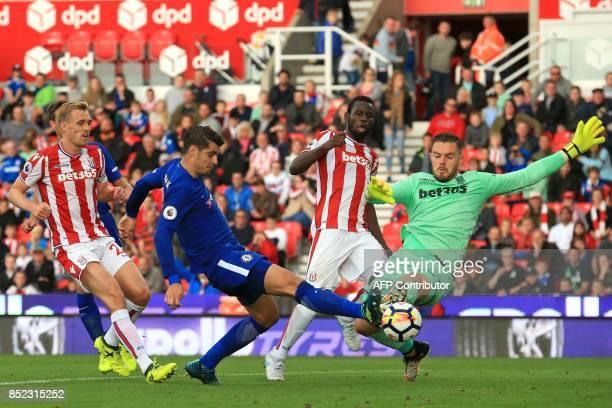 Chelsea's Spanish striker Alvaro Morata shoots past Stoke City's English goalkeeper Jack Butland to score their fourth goal his third during the...