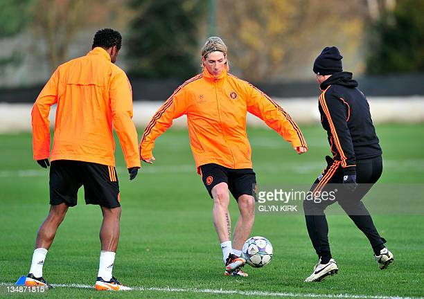 Chelsea's Spanish striker Fernando Torres controls the ball during a training session for their UEFA Champions League group E football match against...