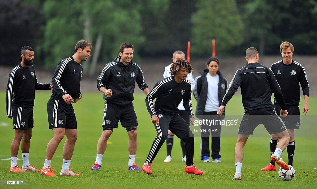 Chelsea's Spanish striker Fernando Torres holds onto the ball watched by Dutch defender Nathan Ake during a training session on April 29 for the...