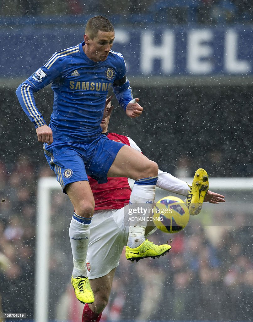 "Chelsea's Spanish striker Fernando Torres jumps to control the ball in front of Arsenal's Belgian defender Thomas Vermaelen (back) during the English Premier League football match between Chelsea and Arsenal at Stamford Bridge in London on January 20, 2013. USE. No use with unauthorized audio, video, data, fixture lists, club/league logos or ""live"" services. Online in-match use limited to 45 images, no video emulation. No use in betting, games or single club/league/player publications."