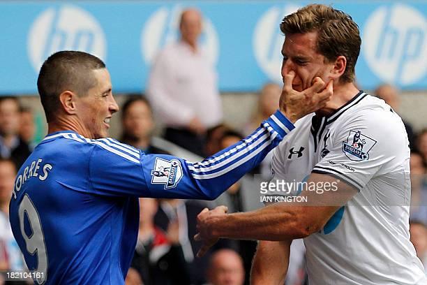Chelsea's Spanish striker Fernando Torres tussles with Tottenham Hotspur's Belgian defender Jan Vertonghen after a tackle during the English Premier...