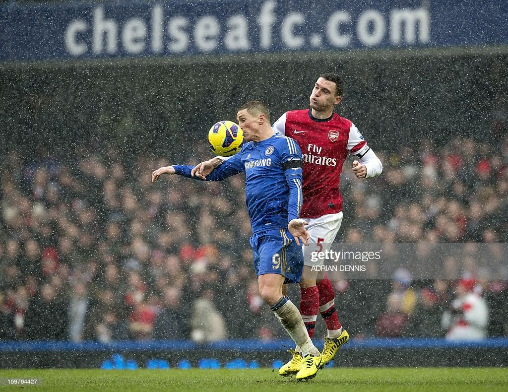 "Chelsea's Spanish striker Fernando Torres (C) vies for the ball against Arsenal's Belgian defender Thomas Vermaelen (R) during the English Premier League football match between Chelsea and Arsenal at Stamford Bridge in London on January 20, 2013. USE. No use with unauthorized audio, video, data, fixture lists, club/league logos or ""live"" services. Online in-match use limited to 45 images, no video emulation. No use in betting, games or single club/league/player publications."