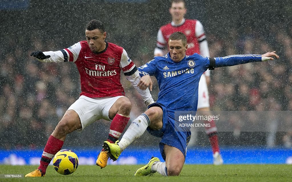 """Chelsea's Spanish striker Fernando Torres (R) vies for the ball against Arsenal's French midfielder Francis Coquelin (L) during the English Premier League football match between Chelsea and Arsenal at Stamford Bridge in London on January 20, 2013. USE. No use with unauthorized audio, video, data, fixture lists, club/league logos or """"live"""" services. Online in-match use limited to 45 images, no video emulation. No use in betting, games or single club/league/player publications."""
