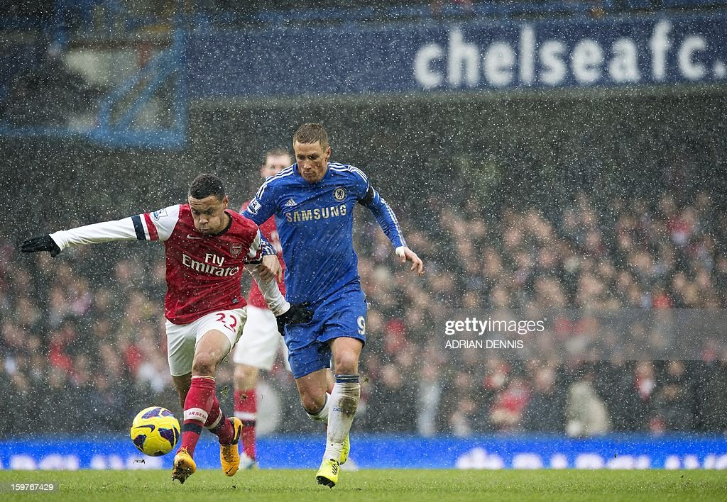 """Chelsea's Spanish striker Fernando Torres (R) vies for the ball against Arsenal's French midfielder Francis Coquelin (L) during the English Premier League football match between Chelsea and Arsenal at Stamford Bridge in London on January 20, 2013. Chelsea won at home for only the second time in in the Premier League under interim manager Rafael Benitez as they held off London rivals Arsenal 2-1 at a snowy Stamford Bridge. AFP PHOTO / ADRIAN DENNIS USE. No use with unauthorized audio, video, data, fixture lists, club/league logos or """"live"""" services. Online in-match use limited to 45 images, no video emulation. No use in betting, games or single club/league/player publications."""