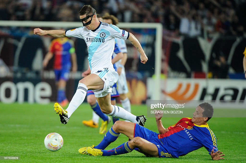 Chelsea's Spanish striker Fernando Torres (L) vies with Basel's Swiss defender Philipp Degen (R) during an UEFA Europa League first leg semi-final football match between Basel and Chelsea at the St Jakob stadium in Basel on April 25, 2013.