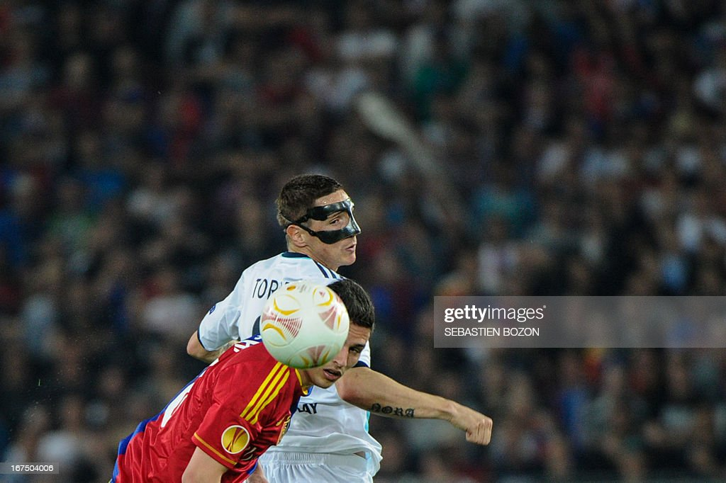 Chelsea's Spanish striker Fernando Torres (2ndL) vies with Basel's Swiss defender Fabian Schar (L) during an UEFA Europa League first leg semi-final football match between Basel and Chelsea at the St Jakob stadium in Basel on April 25, 2013.