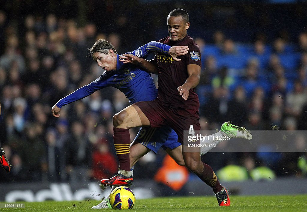 """Chelsea's Spanish striker Fernando Torres (L) vies with Manchester City's Belgium defender Vincent Kompany during an English Premier League football match between Chelsea and Manchester City at Stamford Bridge stadium in London on November 25, 2012. USE. No use with unauthorized audio, video, data, fixture lists, club/league logos or """"live"""" services. Online in-match use limited to 45 images, no video emulation. No use in betting, games or single club/league/player publications"""