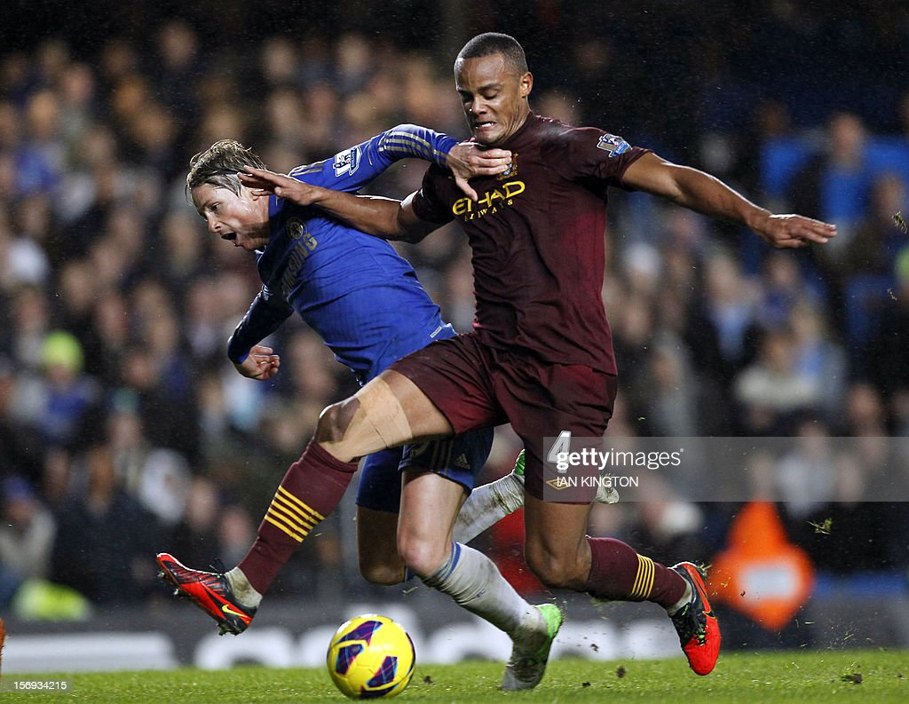 "Chelsea's Spanish striker Fernando Torres (L) vies with Manchester City's Belgium defender Vincent Kompany during an English Premier League football match between Chelsea and Manchester City at Stamford Bridge stadium in London on November 25, 2012. USE. No use with unauthorized audio, video, data, fixture lists, club/league logos or ""live"" services. Online in-match use limited to 45 images, no video emulation. No use in betting, games or single club/league/player publications"