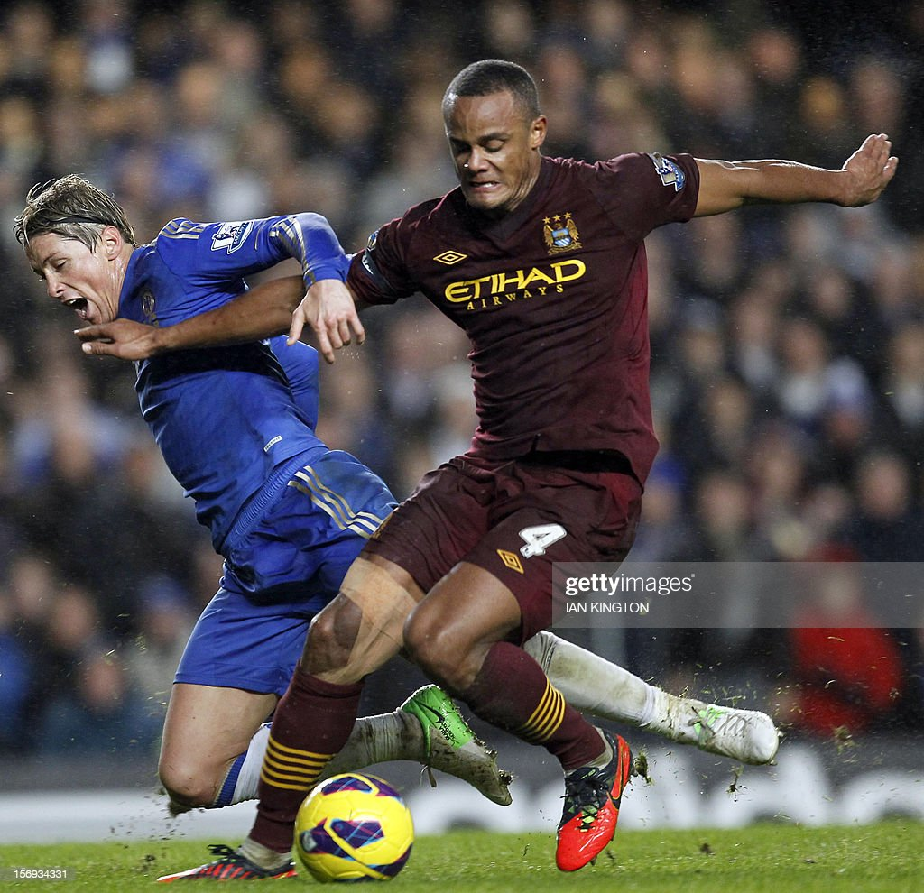 """Chelsea's Spanish striker Fernando Torres (L) vies with Manchester City's Belgian defender Vincent Kompany during an English Premier League football match between Chelsea and Manchester City at Stamford Bridge stadium in London on November 25, 2012. USE. No use with unauthorized audio, video, data, fixture lists, club/league logos or """"live"""" services. Online in-match use limited to 45 images, no video emulation. No use in betting, games or single club/league/player publications"""