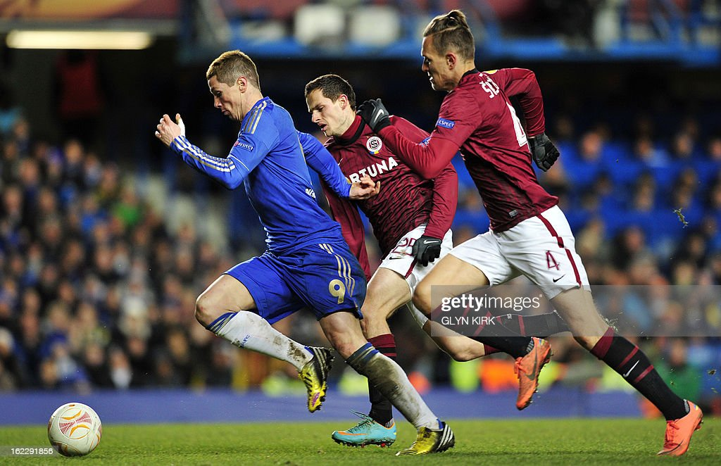 Chelsea's Spanish striker Fernando Torres (L) vies with Sparta Prague's Czech midfielder Mario Holek (2nd L) and Czech defender Ondrej Svejdik (R) during the UEFA Europa League round of 32 football match between Chelsea and Sparta Prague in London on February 21, 2013. The game finished 1-1, Chelsea winning the tie 2-1.