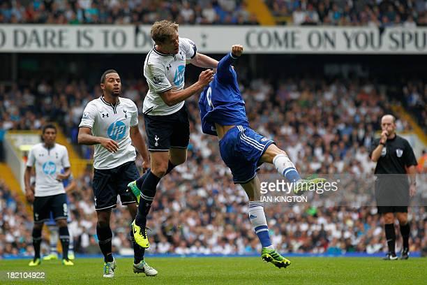 Chelsea's Spanish striker Fernando Torres vies with Tottenham Hotspur's Belgian defender Jan Vertonghen in the air in a challenge that earned Torres...