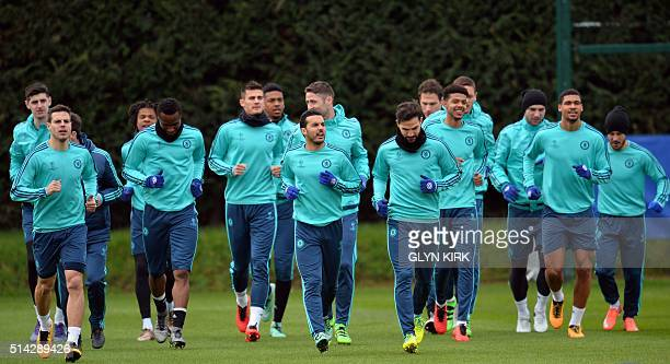 Chelsea's Spanish striker Pedro leads the warm up during training at Chelsea's Cobham training facility in Stoke D'Abernon southwest of London on...