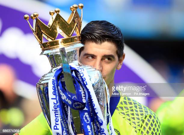 Chelsea's Thibaut Courtois with the premier league trophy following the Premier League match at Stamford Bridge London