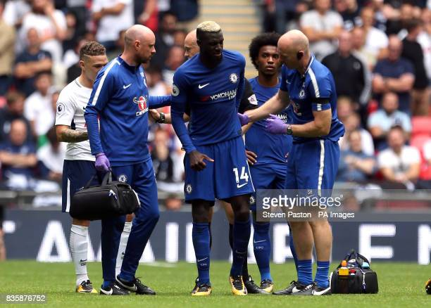 Chelsea's Tiemoue Bakayoko receives treatment during the Premier League match at Wembley Stadium London