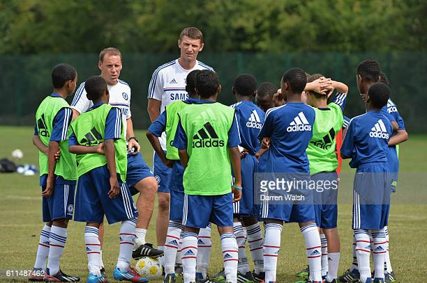 Chelsea's Tore Andre Flo watches the young players during a Academy summer camp training session at the Cobham Training Ground on 22nd August 2013 in...