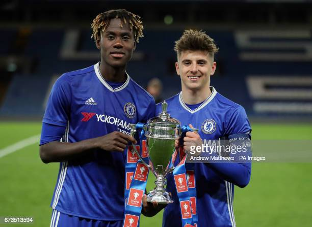 Chelsea's Trevoh Chalobah and captain Mason Moiunt with the trophy after the FA Youth Cup Final Second Leg match at Stamford Bridge London